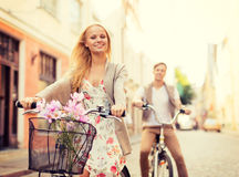 Couple with bicycles in the city. Summer holidays, bikes, love, relationship and dating concept - couple with bicycles in the city royalty free stock photos