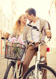 Couple with bicycles in the city Royalty Free Stock Photo