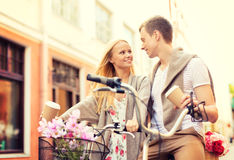Couple with bicycles in the city Royalty Free Stock Image