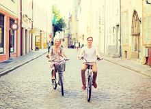 Couple with bicycles in the city Stock Photography