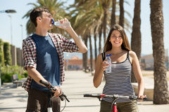 Couple with bicycles drink water Royalty Free Stock Photos
