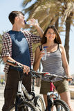 Couple with bicycles drink water Stock Photos