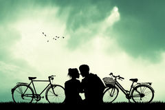 Couple with bicycles at sunset Royalty Free Stock Images