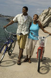 Couple With Bicycles Walking On Beach Royalty Free Stock Image