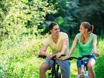 Couple on bicycles Stock Photos
