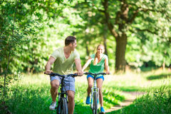 Couple on bicycles Royalty Free Stock Images