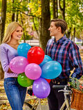 Couple with big basket of flowers in the park Stock Photography