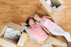 Couple with big cardboard boxes moving to new home Royalty Free Stock Images
