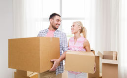 Couple with big cardboard boxes moving to new home Stock Photo