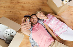 Couple with big cardboard boxes moving to new home Royalty Free Stock Photography