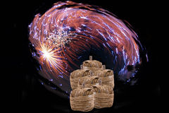 Couple of big firecracker in front of light sparkles Stock Image
