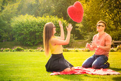 Couple with big heart on picnic Stock Photo