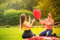 Couple with big heart on picnic Stock Image