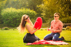 Couple with big heart on picnic Royalty Free Stock Photos