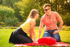Couple with big heart on picnic Royalty Free Stock Photography