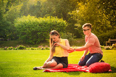 Couple with big heart on picnic Stock Images