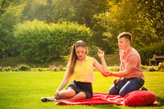 Couple with big heart on picnic Royalty Free Stock Image