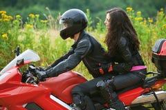 Couple on bike Stock Image