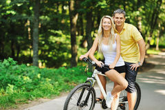 Couple on a bike in a countryside Stock Image