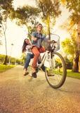 Couple on bike Stock Images