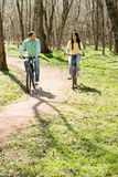Couple on bike outdoors Royalty Free Stock Photos