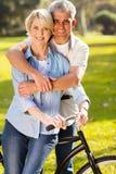 Couple bike outdoors stock photo