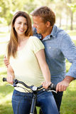 Couple with bike in park Stock Photos
