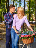 Couple with bike in park. Stock Photos