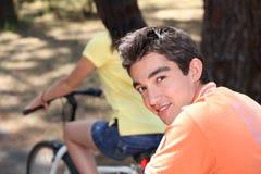 Couple on bike ride. A teen couple on bike ride Stock Photos