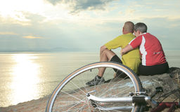 Couple bike sunset Stock Photography