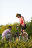 Couple With a Bike - Vertical Royalty Free Stock Photo