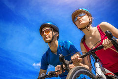Couple of bikers against the sky Stock Image