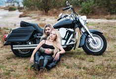 Couple of bikers on the beach Stock Photo
