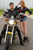 Couple bikers motorcyclists on the road Royalty Free Stock Photos