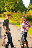 Couple with Bikes Stock Photo