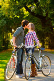 Couple with Bikes Stock Images