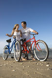 Couple with Bikes at the Beach Stock Images