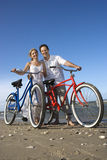 Couple with Bikes at the Beach Royalty Free Stock Images