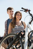 Couple with bikes on beach Stock Photo