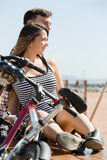 Couple with bikes on beach Royalty Free Stock Photography
