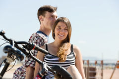 Couple with bikes on beach Stock Photography