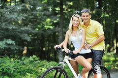 Couple on a bikes in countryside Royalty Free Stock Image