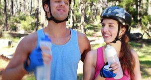 Couple with bikes drinking water stock video