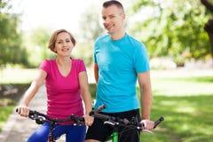 Couple on bikes outdoors Royalty Free Stock Photo