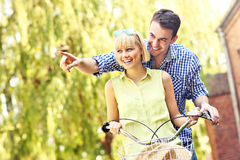 Couple on bikes in the park Royalty Free Stock Photos