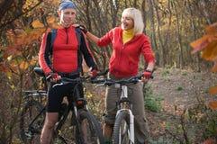 Couple biking Royalty Free Stock Photo