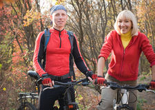 Couple biking Stock Image