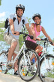Couple biking Royalty Free Stock Photo