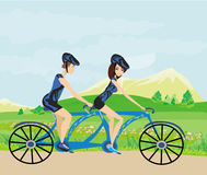 Couple biking in the mountains Royalty Free Stock Photos