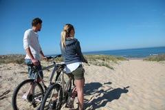Couple on a biking trip to the seaside Stock Photos